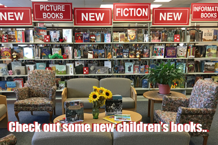 "new book section of the library with the caption ""Check out some new children's books..."""