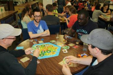 Students playing games during our Board Game Tournament during Orientation 2014